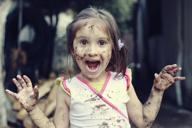 Mud girl wondering