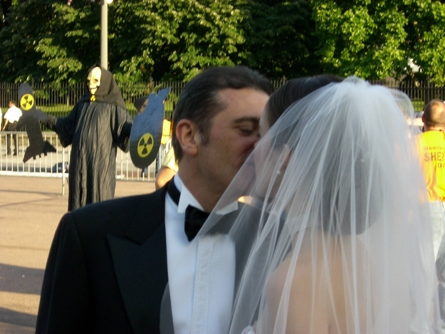 Wedding photobomb #6: So this is not unnerving at all. Who invited the Reaper?