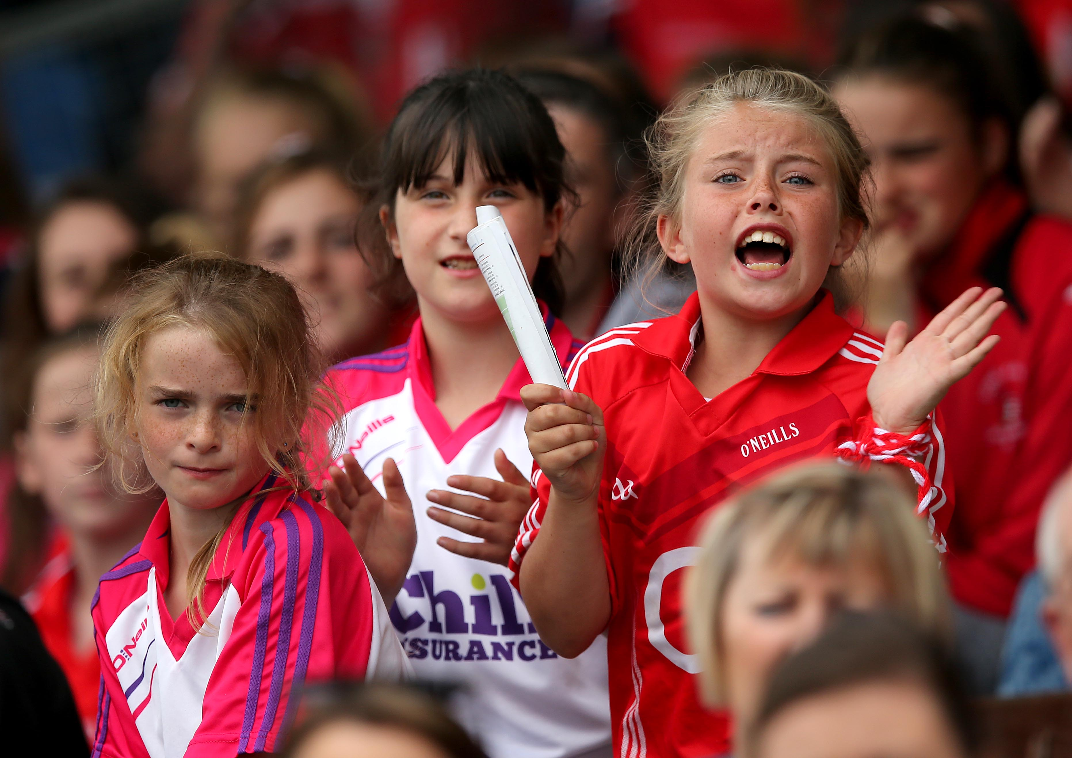 REPRO FREE***PRESS RELEASE NO REPRODUCTION FEE*** Liberty Insurance Senior Camogie Championship Semi-Final, Walsh Park, Waterford 16/8/2015 Kilkenny vs Cork A young Cork fan cheers on her team near the end of the game Mandatory Credit ©INPHO/Ryan Byrne