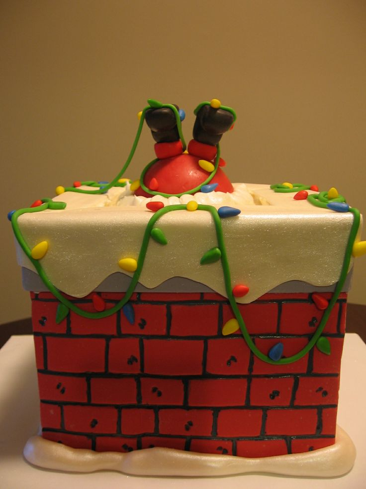12 Of The Most Amazing Christmas Cake Decorating Ideas: santa stuck in chimney cake