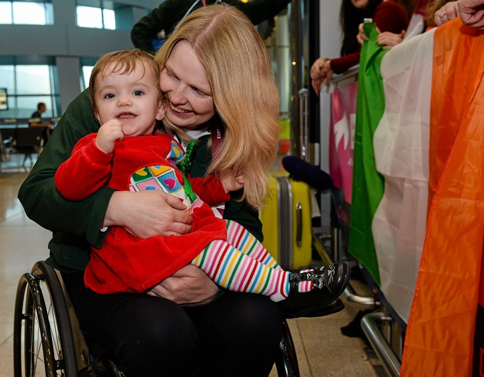 1 November 2015; Deirdre Mongan, originally from Milltown, Co. Galway, now living in Newcastle, Co. Down, who won bronze in the F53 shot put, is greeted by her 15-month-old daughter Amy upon her arrival. Paralympics Ireland Team Homecoming from the IPC Athletics World Championships, in Doha, Qatar. Terminal 2, Dublin Airport. Picture credit: Cody Glenn / SPORTSFILE *** NO REPRODUCTION FEE ***