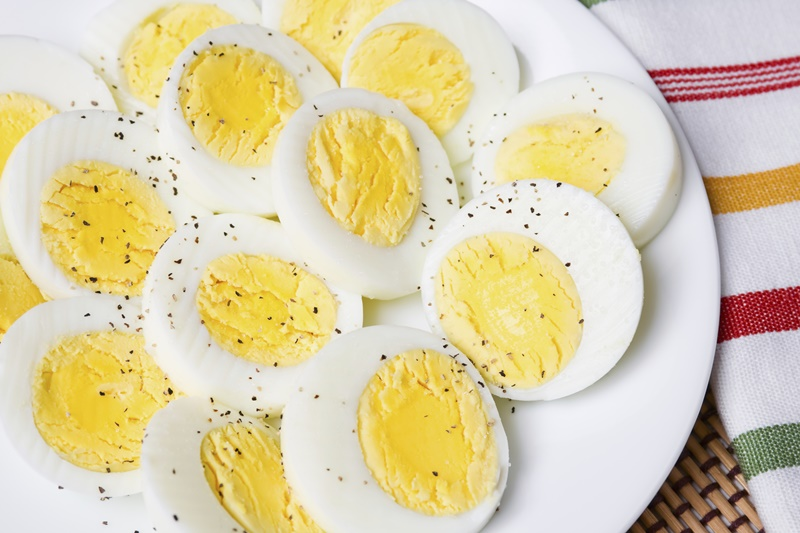 Sliced hard boiled eggs with salt and pepper