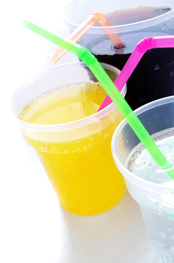 fizzy soda drinks with straws on white background