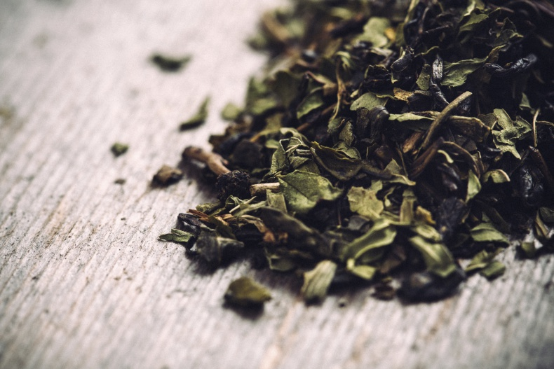 Dried green tea leaves ready to be brewed into a antioxidant rich, hot cup of tea.