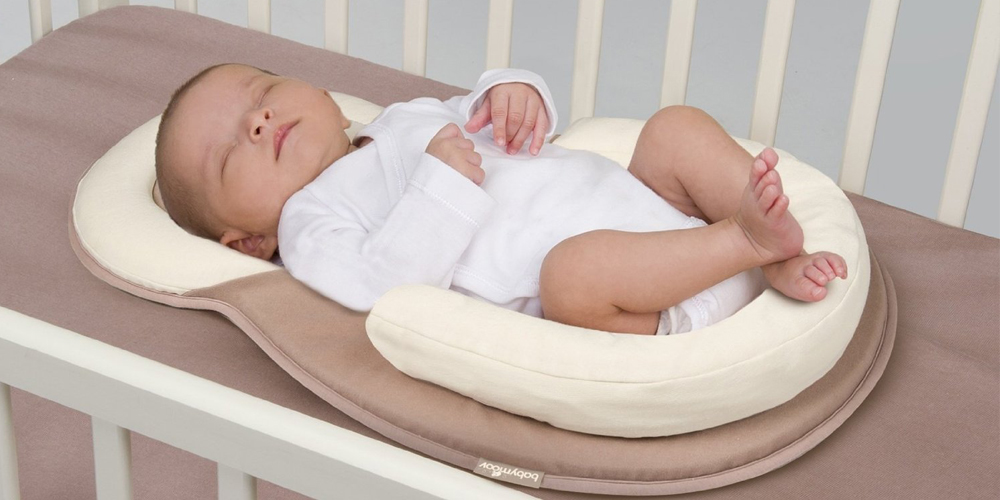 Several UK retailers pull baby sleep positioners from sale over ... a09a37afa